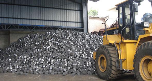 bucket loader loads aluminum briquette in warehouse