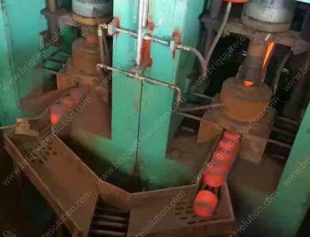 hot DRI briquette output from hydraulic briquetting machine