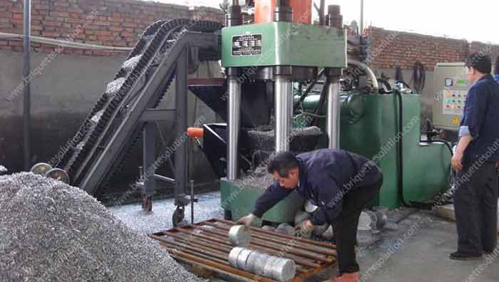a running hydraulic briquette plant with aluminum scrap