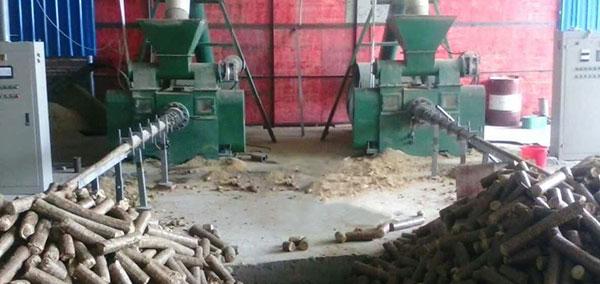 two sets of log briquette maker is making biomass briquette