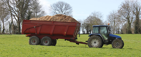 wood sawdust is taken by a tractor for drying